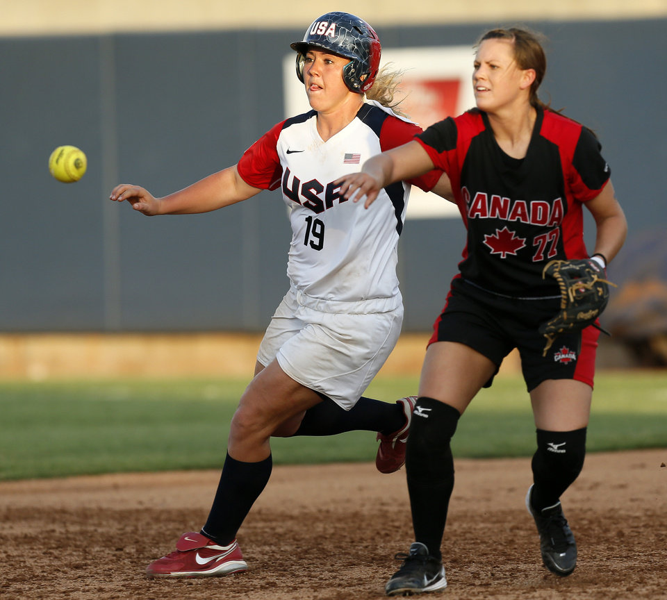 Photo - Sara Hopwood (77) of Canada throws the ball to second base to get out Amanda Chidester (19) of the United States in the third inning during a game between Team USA and Canada in the World Cup of Softball at ASA Hall of Fame Stadium in Oklahoma City, Thursday, July 11, 2013. Team USA won 7-0 in 6 innings. Photo by Nate Billings, The Oklahoman