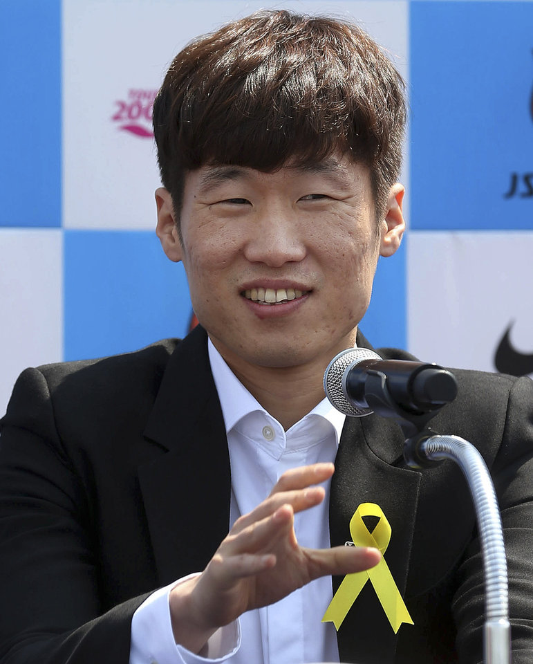 Photo - Park Ji-sung, a former Manchester United regular and one of the stars of South Korea's run to the 2002 World Cup soccer semifinals, speaks during a press conference in Suwon, South Korea, Wednesday, May 14, 2014. Park announced his retirement from top-flight football. (AP Photo/Yonhap, Kim Soo-jin) KOREA OUT