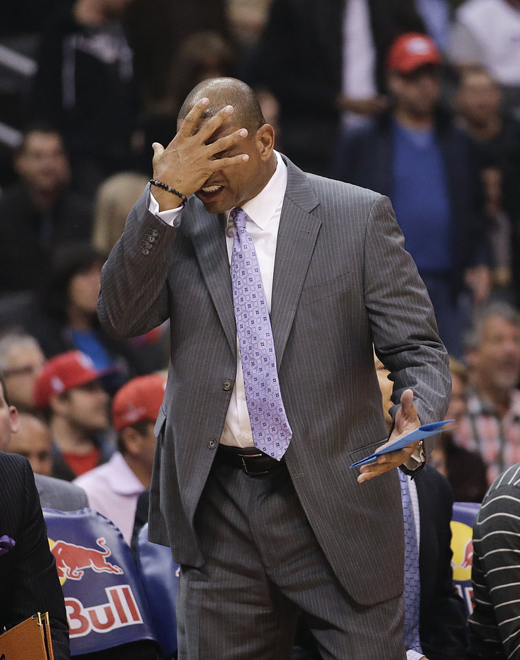 Los Angeles Clippers\' Doc Rivers reacts while directing his team during the first half of an NBA basketball game against the Brooklyn Nets on Saturday, Nov. 16, 2013, in Los Angeles. (AP Photo/Jae C. Hong)