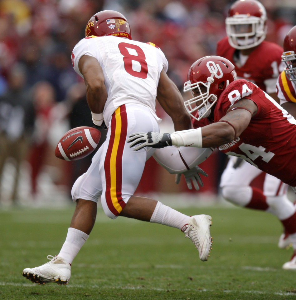 Photo - Oklahoma's Frank Alexander (84) forces Iowa State's James White (8) to fumble during a college football game between the University of Oklahoma Sooners (OU) and the Iowa State University Cyclones (ISU) at Gaylord Family-Oklahoma Memorial Stadium in Norman, Okla., Saturday, Nov. 26, 2011. Photo by Bryan Terry, The Oklahoman