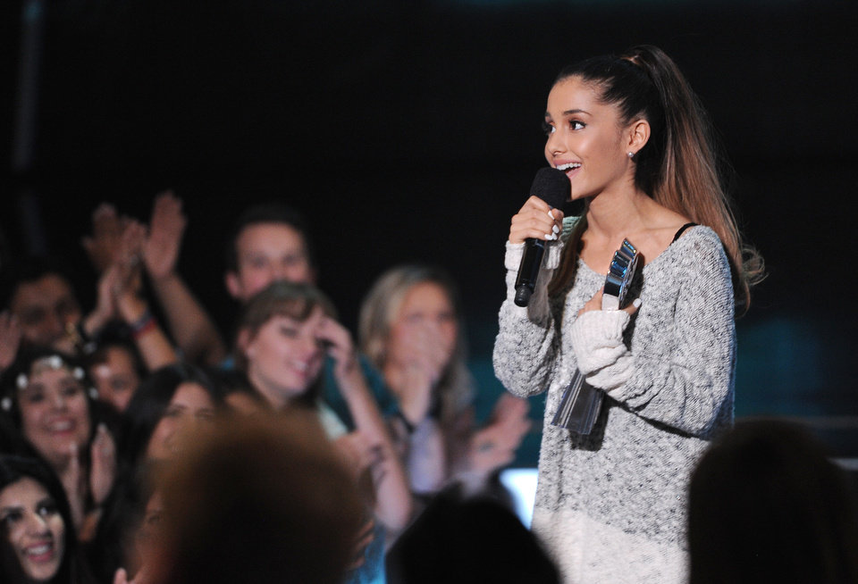 """Photo - FILE - In this May 1, 2014 file photo, Ariana Grande speaks at the iHeartRadio Music Awards at the Shrine Auditorium, in Los Angeles. Grande is having a breakthrough in music with the multiplatinum hit """"Problem,"""" which is spending its 13th week in the top 10 on the Billboard Hot 100 chart. The song features rapper Iggy Azalea and is from Grande's sophomore album, """"My Everything,"""" to be released Aug. 25, 2014. (Photo by Chris Pizzello/Invision/AP, file)"""