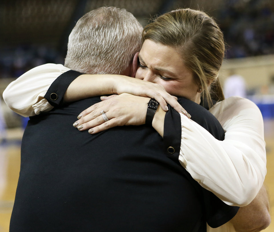Photo - Pond Creek-Hunter coach Tasha Diesselhorst gets a hug from her father, Randy Turney, a former coach, after her team won a Class A girls semifinal high school basketball game in the state championship tournament between Pond Creek-Hunter and Cheyenne/Reydon at The Big House, Jim Norick State Fair Arena, in Oklahoma City, Friday, March 7, 2014. Photo by Nate Billings, The Oklahoman