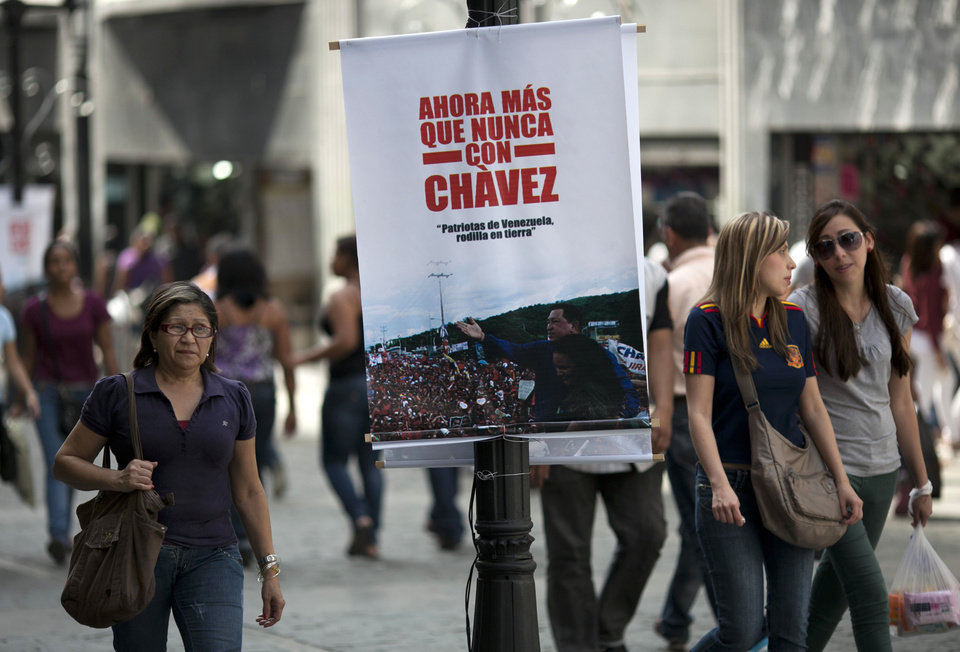 "A banner that reads in Spanish ""Now more than ever with Chavez"" on a street pole in Caracas, Venezuela, Saturday, Dec. 15, 2012. Hugo Chavez's cancer has upended politics in Venezuela, transforming Sunday's nationwide elections for state governors and legislators into a test of his legacy that could chart the country's future in the uncertain months ahead. (AP Photo/Ariana Cubillos)"