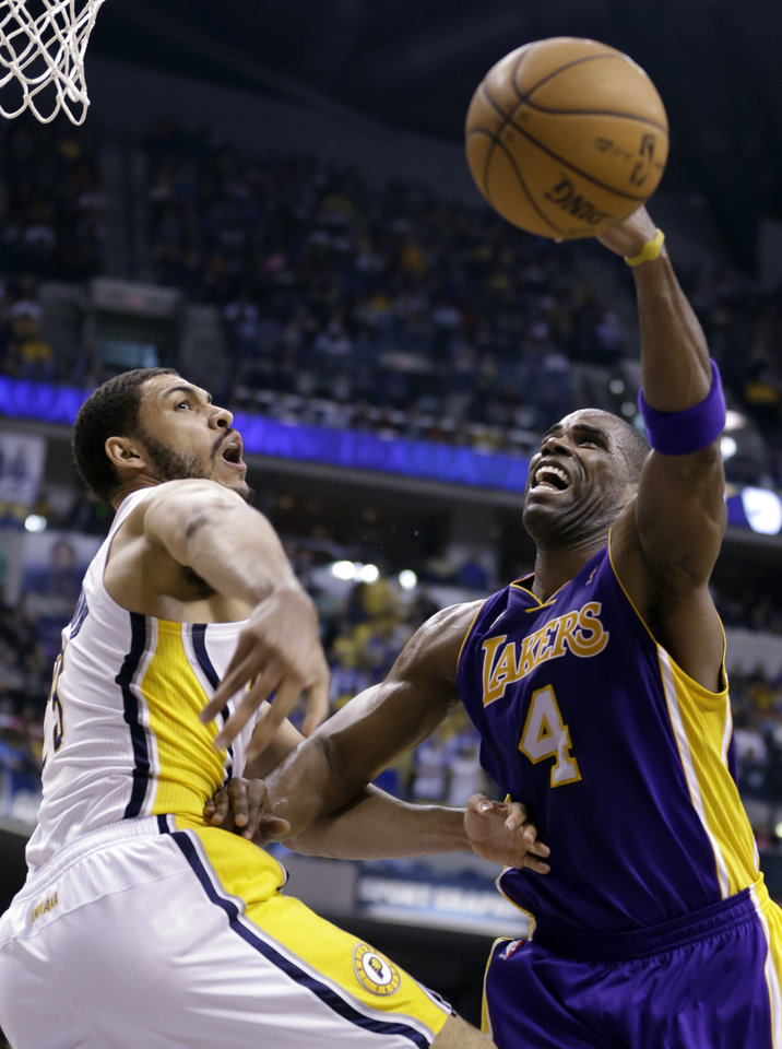 Photo - Indiana Pacers forward Jeff Pendergraph, left, blocks the shot of Los Angeles Lakers forward Antawn Jamison during the first half of an NBA basketball game in Indianapolis, Friday, March 15, 2013. (AP Photo/Michael Conroy)