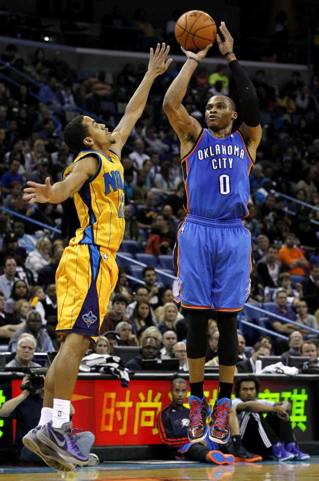 Photo - Oklahoma City Thunder point guard Russell Westbrook (0) shoots the ball over New Orleans Hornets point guard Brian Roberts (22) during the second half of an NBA basketball game in New Orleans, Friday, Nov. 16, 2012. The Thunder won 110-95. (AP Photo/Jonathan Bachman) ORG XMIT: LAJB119