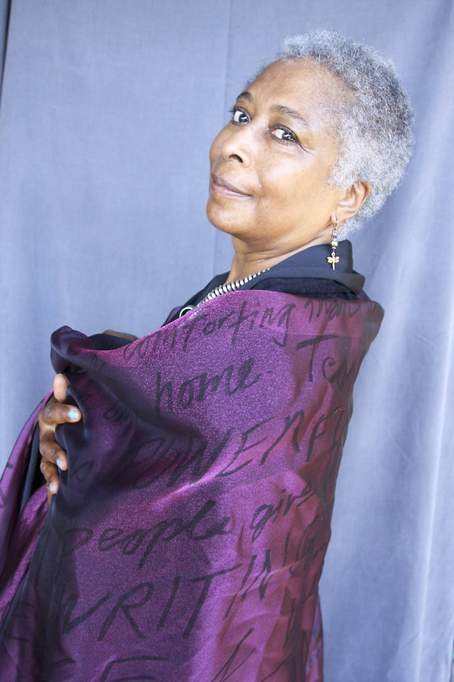 Photo - Alice Walker poses with a scrim of her writings for a photo by M.J. Alexander.Photo by M.J. Alexander
