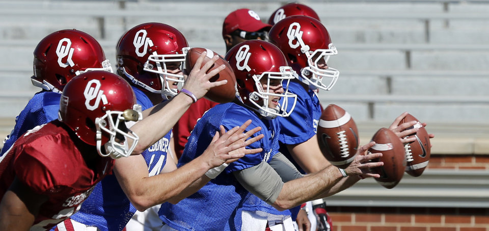 Photo - Quarterbacks including Cody Thomas and Trevor Knight go through drills as the University of Oklahoma Sooners (OU) begin spring practice on Owen Field at Gaylord Family-Oklahoma Memorial Stadium in Norman, Okla., on Tuesday, March 11, 2014. Photo by Steve Sisney, The Oklahoman