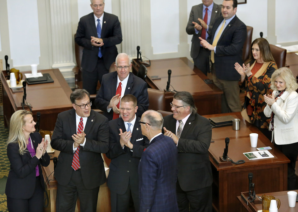 Photo - His Republican leadership colleagues congratulate Harold Wright, Weatherford, back to camera,  after members elected him to the position of speaker pro tempore. Wright addressed lawmakers after he was sworn in. The state Legislature met in their separate chambers at the state Capitol Tuesday afternoon, Jan. 8, 2019, for an organizational day.  Senators joined state representatives in the House to conduct a brief joint session. Photo by Jim Beckel, The Oklahoman.