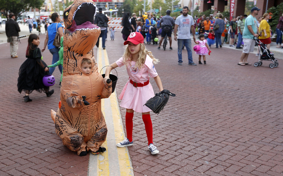 Photo - Kaidence Holland, 8, right, and Tanner Holland trick or treat during the Brick or Treat in Bricktown in Oklahoma City, Tuesday, Oct. 25, 2016.   Photo by Sarah Phipps, The Oklahoman