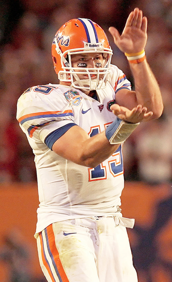 Photo - Florida quarterback Tim Tebow was assessed a personal foul penalty for flashing the Gator chomp at the OU defense during the BCS National Championship game. Photo by Tim Casey, gatorcountry.com