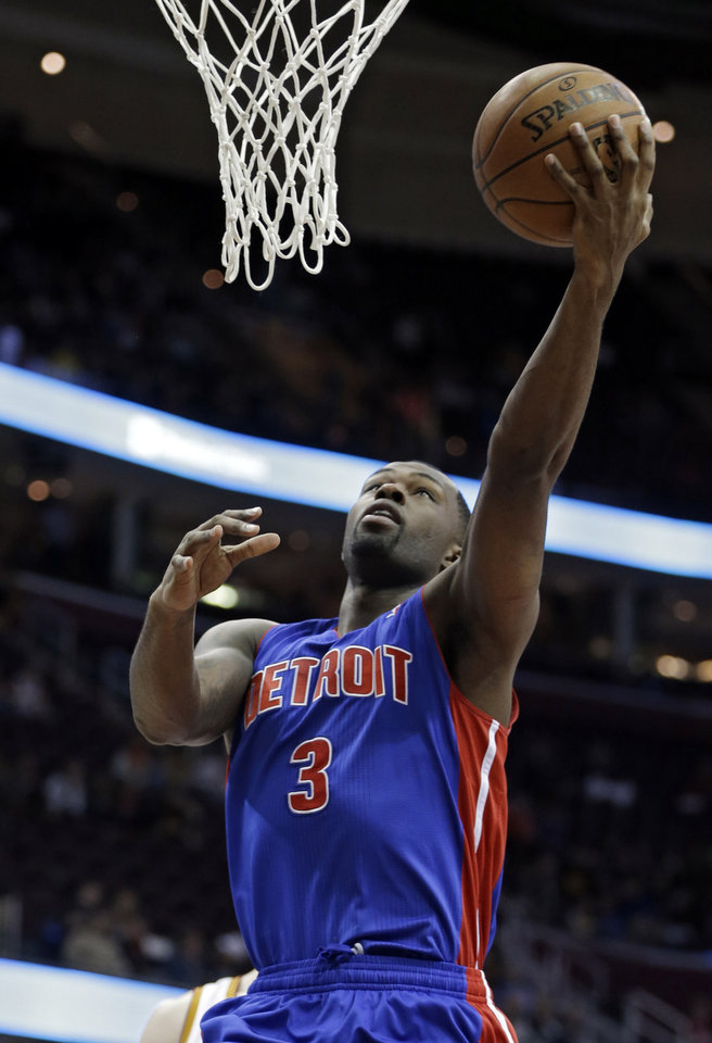 Photo - Detroit Pistons' Rodney Stuckey (3) shoots against the Cleveland Cavaliers in the first quarter of an NBA basketball game on Wednesday, April 10, 2013, in Cleveland. (AP Photo/Mark Duncan)