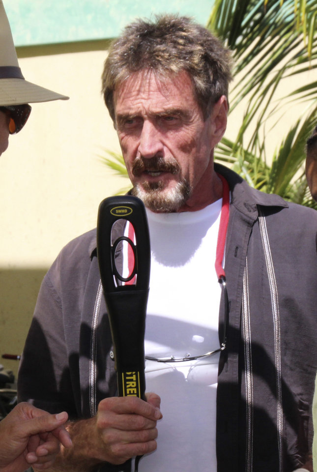 Photo -   In this Thursday Nov. 8, 2012 photo software company founder John McAfee speaks at the official presentation of equipment ceremony that took place at the San Pedro Police Station in Ambergris Caye, Belize. McAfee, 67, has been identified as a
