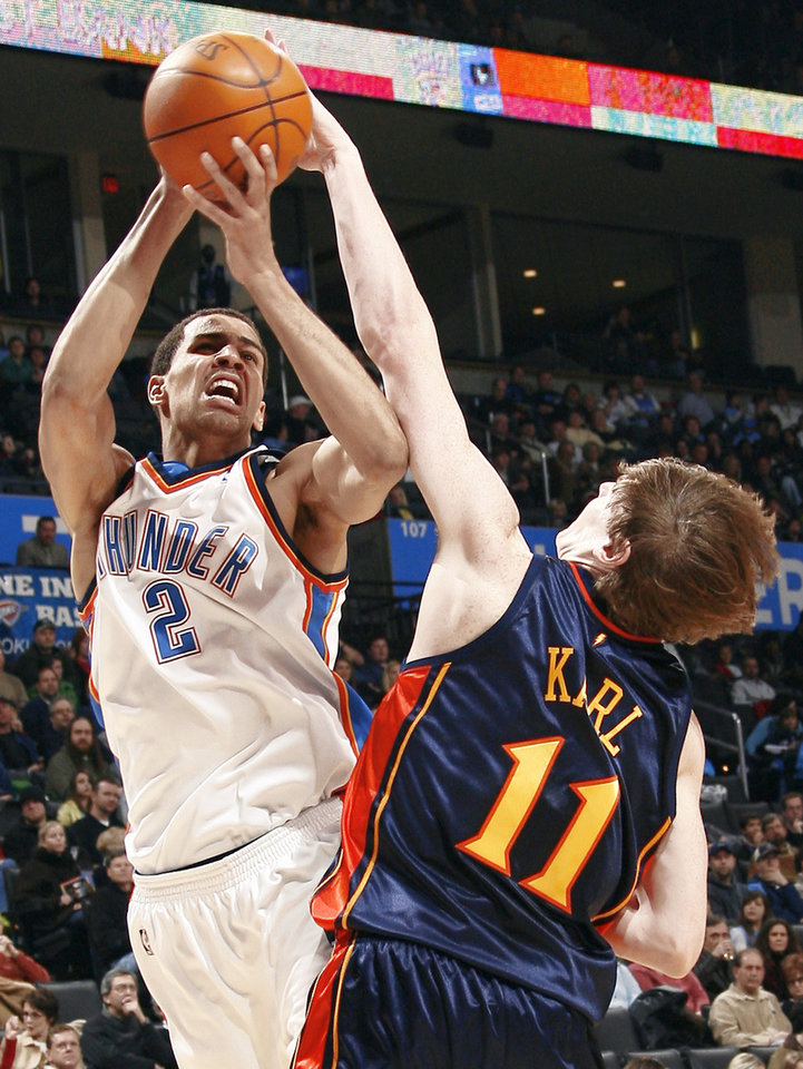Photo - The Thunder's Thabo Sefolosha, left, shoots over Golden State's Coby Karl during Sunday's game at the Ford Center. Photo by Sarah Phipps, The Oklahoman