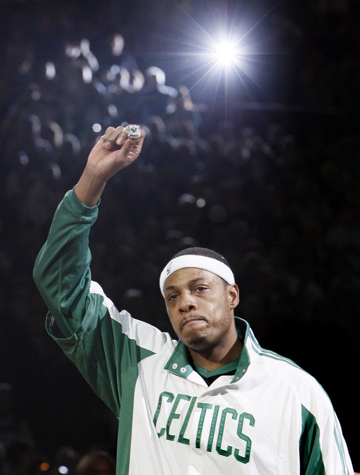 Photo - Paul Pierce of the Boston Celtics shows his NBA championship ring to the crowd during ceremonies prior to an NBA basketball game against the Cleveland Cavaliers in Boston on Tuesday, Oct. 28, 2008. The Celtics defeated the Lakers to win the 2008 championship. (AP Photo/Winslow Townson) ORG XMIT: MAEA102