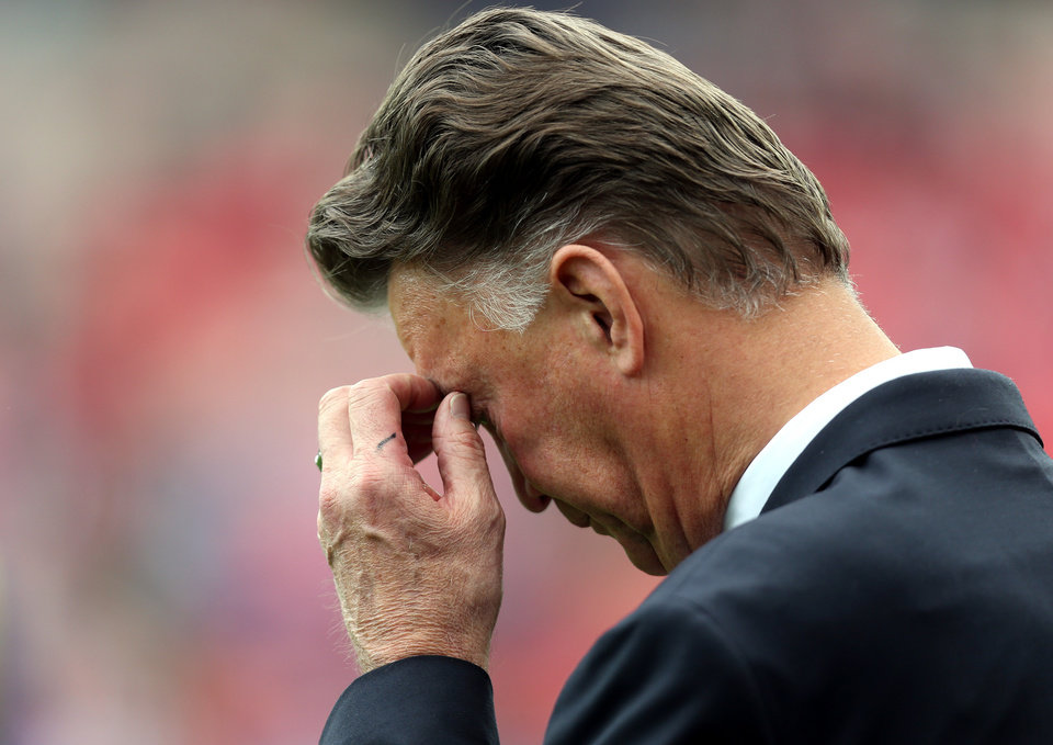 Photo - Manchester United's manager Louis Van Gaal looks on ahead of their English Premier League soccer match against Sunderland at the Stadium of Light, Sunderland, England, Sunday, Aug. 24, 2014. (AP Photo/Scott Heppell)