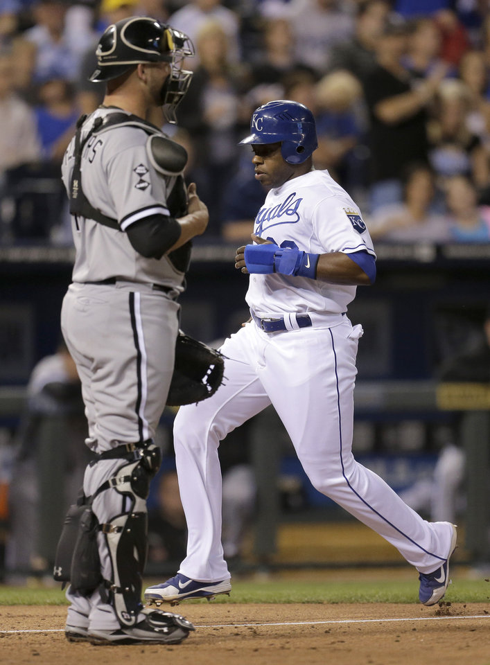 Photo -   Kansas City Royals' Jason Bourgeois runs past Chicago White Sox catcher Tyler Flowers to score on a sacrifice fly by Billy Butler during the third inning of a baseball game Wednesday, Sept. 19, 2012, in Kansas City, Mo. (AP Photo/Charlie Riedel)