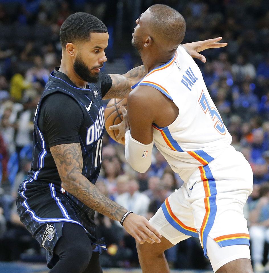 Photo - Oklahoma City's Chris Paul (3) is fouled by Orlando's D.J. Augustin (14) during an NBA basketball game between the Oklahoma City Thunder and the Orlando Magic at Chesapeake Energy Arena in Oklahoma City, Tuesday, Nov. 5, 2019. Oklahoma City won 102-94. [Bryan Terry/The Oklahoman]