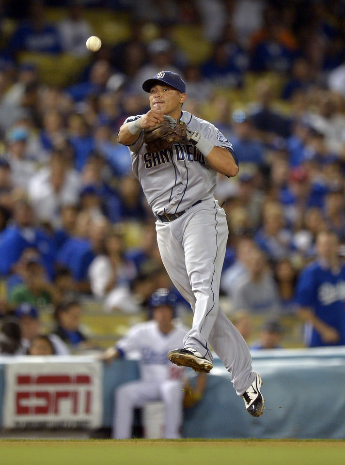 Photo -   San Diego Padres shortstop Everth Cabrera attempts to throw out Los Angeles Dodgers' A.J. Ellis at first during the seventh inning of their baseball game, Tuesday, Sept. 4, 2012, in Los Angeles. Ellis was safe at first on the play. (AP Photo/Mark J. Terrill)