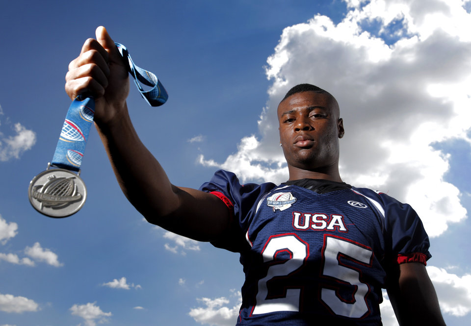 Khari Harding poses for a photo with his silver metal and Team USA jersey at Wantland Stadium at the University of Central Oklahoma in Edmond, Okla., Monday, July 16, 2012.  Photo by Garett Fisbeck, The Oklahoman