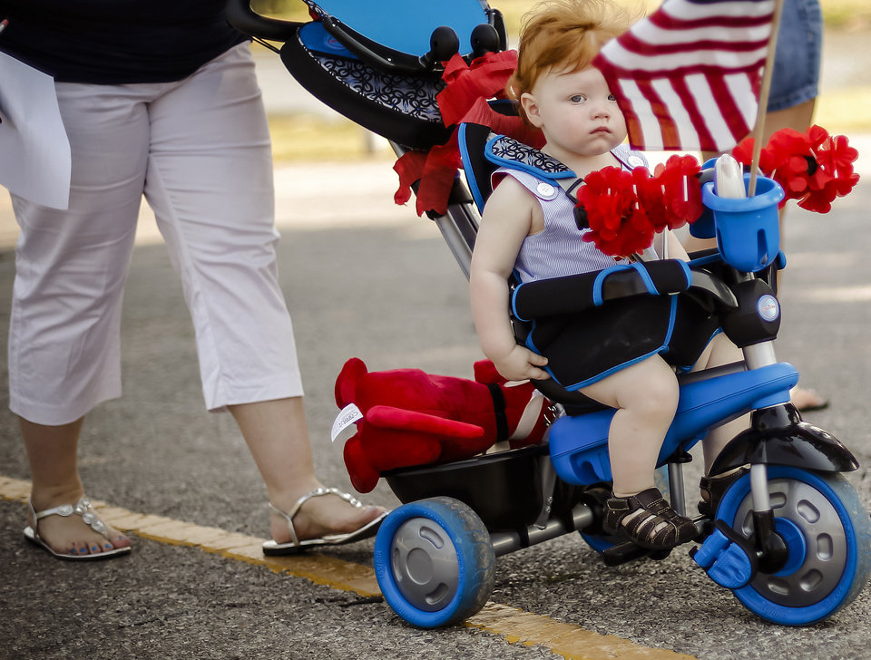 Micah Maloney, 13 months, rides his bike in the children's parade during the Yukon Freedom Fest at the Yukon City Park on Thursday , July 4, 2013, in Yukon, Okla. Photo by Chris Landsberger, The Oklahoman