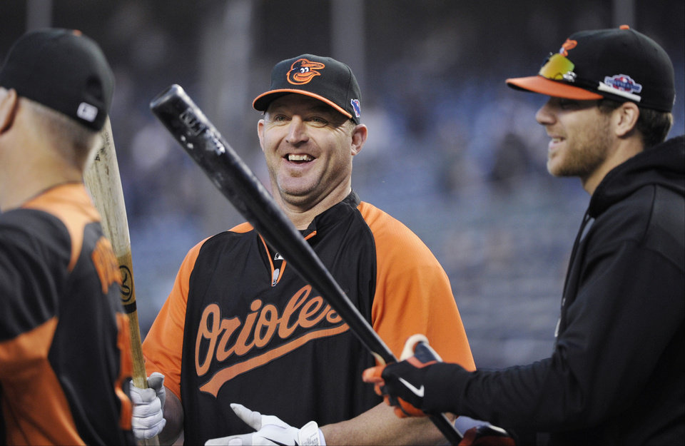 Baltimore Orioles designated hitter Jim Thome, center, laughs with teammate Chris Davis, right, before Game 3 of the Orioles' American League division baseball series against the New York Yankees, Wednesday, Oct. 10, 2012, in New York. (AP Photo/Bill Kostroun)