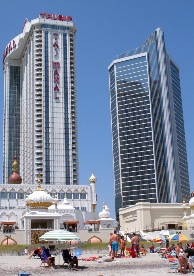 Photo - This July 23, 2014 photo shows the Trump Taj Mahal Casino Resort in Atlantic City N.J. On Tuesday Aug. 5, 2014, Donald Trump sued Trump Entertainment Resorts, seeking to force the company to remove his name from its two Atlantic City casinos, Trump Plaza and the Trump Taj Mahal, alleging the company had allowed the casinos to fall into disrepair and tarnish the real estate mogul's personal brand. (AP Photo/Wayne Parry)