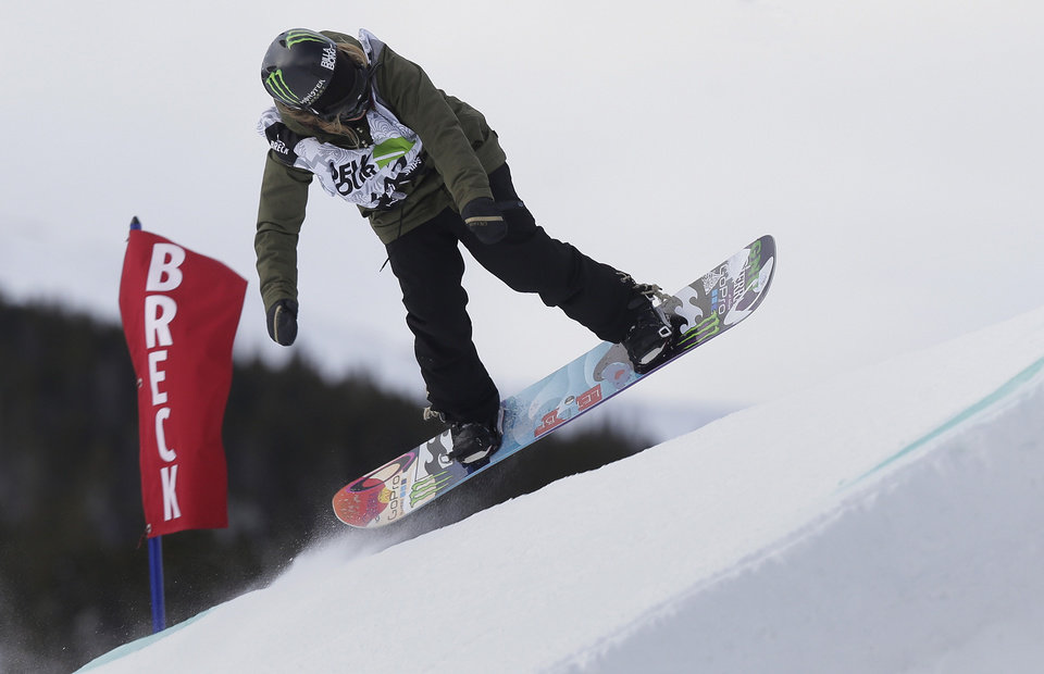 Jamie Anderson launches off a jump during the women's slopestyle snowboarding final at the Dew Tour iON Mountain Championships, Friday, Dec. 13, 2013, in Breckenridge, Colo. Anderson won the event (AP Photo/Julie Jacobson)