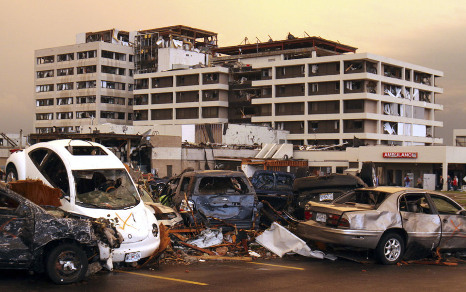 Photo - Destroyed vehicles are piled on top of one another in the parking lot of the Joplin Regional Medical Center in Joplin, Mo., Sunday, May 22, 2011. A large tornado moved through much of the city, damaging the hospital and hundreds of homes and businesses. (AP Photo/Mark Schiefelbein) ORG XMIT: MOMS107
