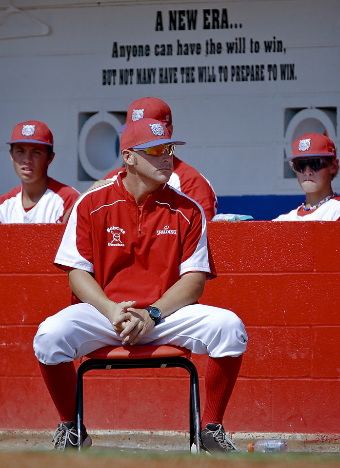 Photo - Former Major League Baseball player and current head coach of the Binger-Oney High School baseball team Reggie Willits looks on as the Bobcats play a game on Thursday, Sept. 20, 2012, in Binger, Okla. Photo by Chris Landsberger, The Oklahoman