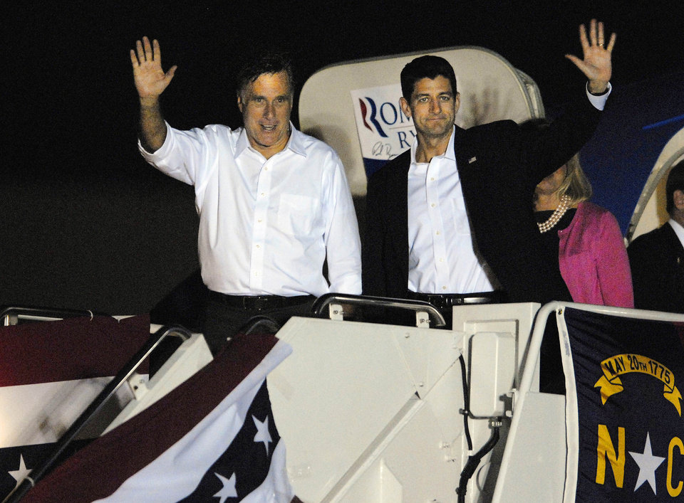 Photo -   Republican presidential candidate, former Massachusetts Gov. Mitt Romney, right, and vice presidential running mate Rep. Paul Ryan R-Wis. arrive at Wilson Air Field in Charlotte, N.C. on Saturday, Aug. 11, 2012 (AP Photo/The Charlotte Observer, Adam Jennings)