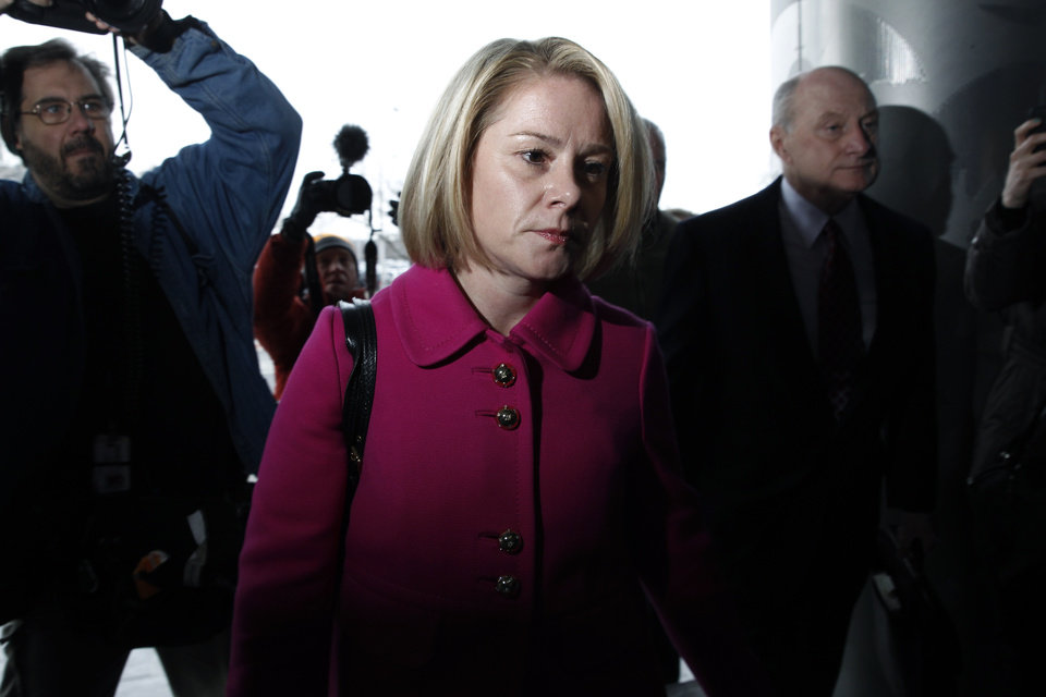 Photo - New Jersey Gov. Chris Christie's former Deputy Chief of Staff Bridget Kelly, and her attorney Michael Critchley, right, arrive at court for a hearing Tuesday, March 11, 2014, in Trenton, N.J.  Attorneys for Kelly and two-time campaign manager Bill Stepien are in court to try to persuade a judge not to force them to turn over text messages and other private communications to New Jersey legislators investigating the political payback scandal ensnaring Christie's administration. (AP Photo/Mel Evans)