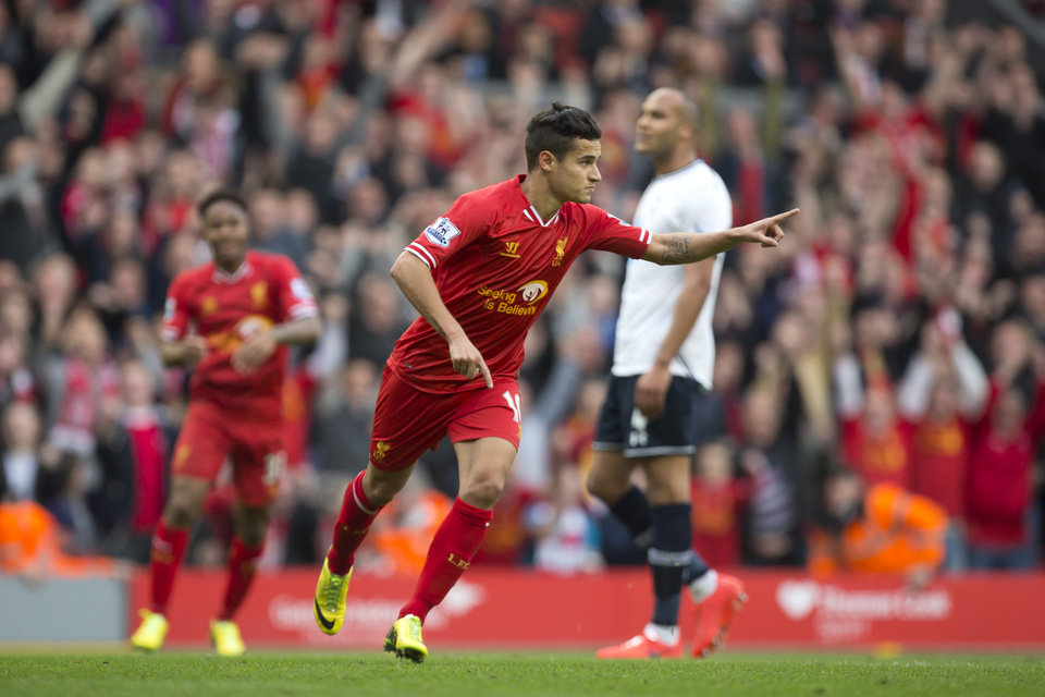 Photo - Liverpool's Philippe Coutinho celebrates after scoring against Tottenham during their English Premier League soccer match at Anfield Stadium, Liverpool, England, Sunday March 30, 2014. (AP Photo/Jon Super)