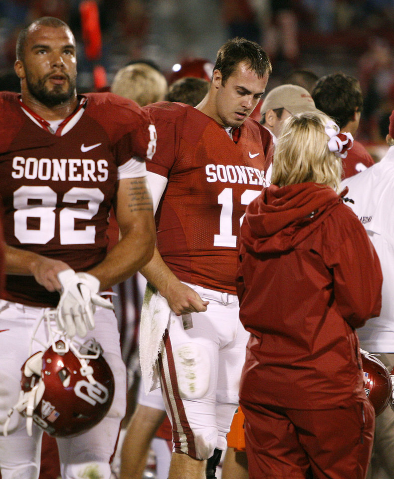 Photo - Oklahoma's Landry Jones (12) walks the sidelines during the college football game between the University of Oklahoma Sooners (OU) and the Texas Tech University Red Raiders (TTU) at Gaylord Family-Oklahoma Memorial Stadium in Norman, Okla., Sunday, Oct. 23, 2011. Oklahoma lost 41-38. Photo by Bryan Terry, The Oklahoman