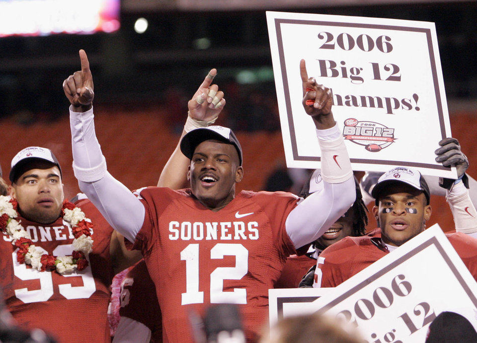 Photo - C.J Ah You (99), Paul Thompson (12) and D.J. Wolfe (25) celebrate after the 21-7 win over the Huskers in the Big 12 Championship game during the University of Oklahoma Sooners (OU) college football game against the University of Nebraska Cornhuskers (NU) at Arrowhead Stadium, on Saturday, Dec. 2, 2006, in Kansas City, Mo.   by Chris Landsberger, The Oklahoman  ORG XMIT: KOD ORG XMIT: OKC0612022328364177