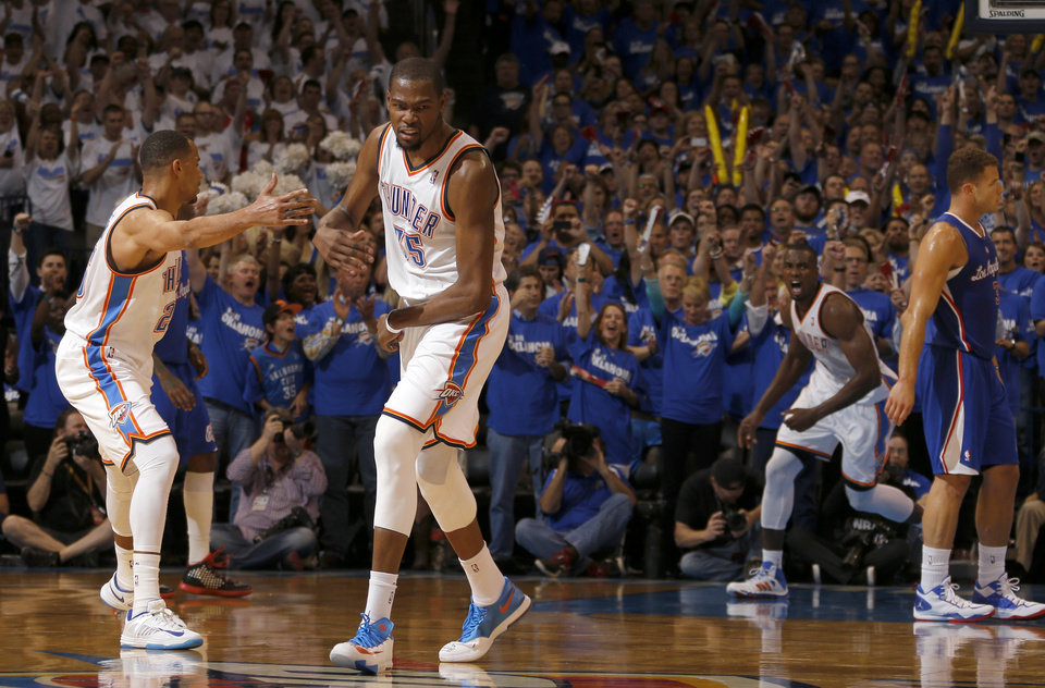 Photo - Oklahoma City's Kevin Durant (35) celebrates with Thabo Sefolosha (25) during Game 2 of the Western Conference semifinals in the NBA playoffs between the Oklahoma City Thunder and the Los Angeles Clippers at Chesapeake Energy Arena in Oklahoma City, Wednesday, May 7, 2014. Photo by Bryan Terry, The Oklahoman