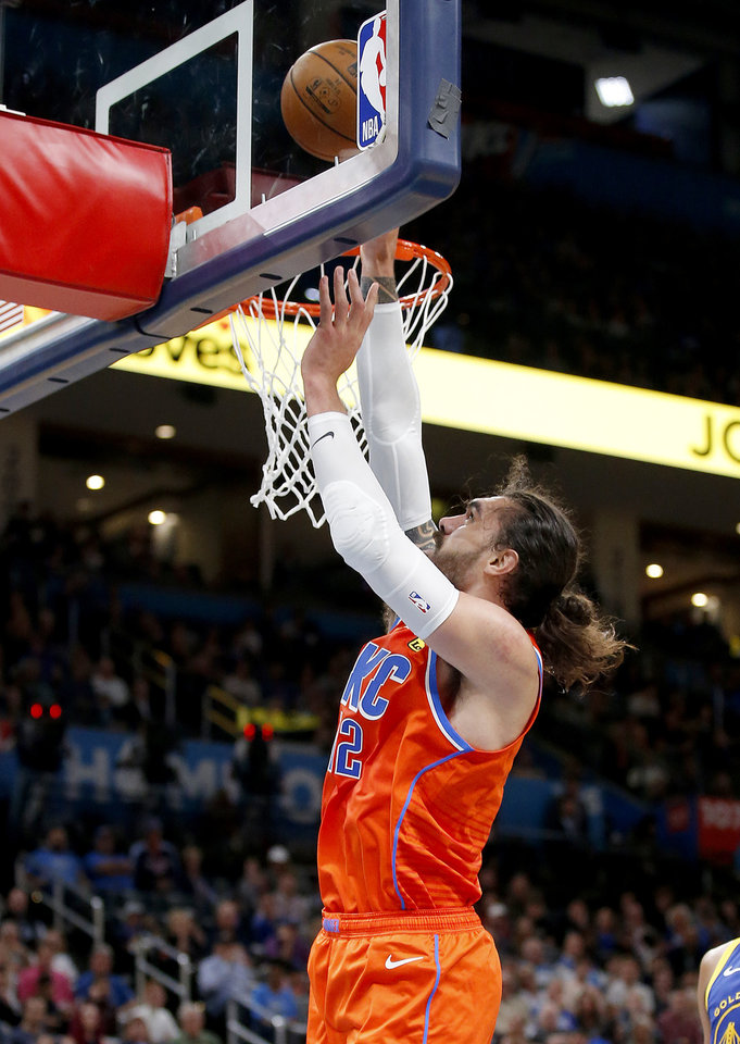Photo - Oklahoma City's Steven Adams (12) goes up for a basket during the NBA game between the Oklahoma City Thunder and Golden State Warriors at Chesapeake Energy Arena,  Sunday, Oct. 27, 2019. [Sarah Phipps/The Oklahoman]