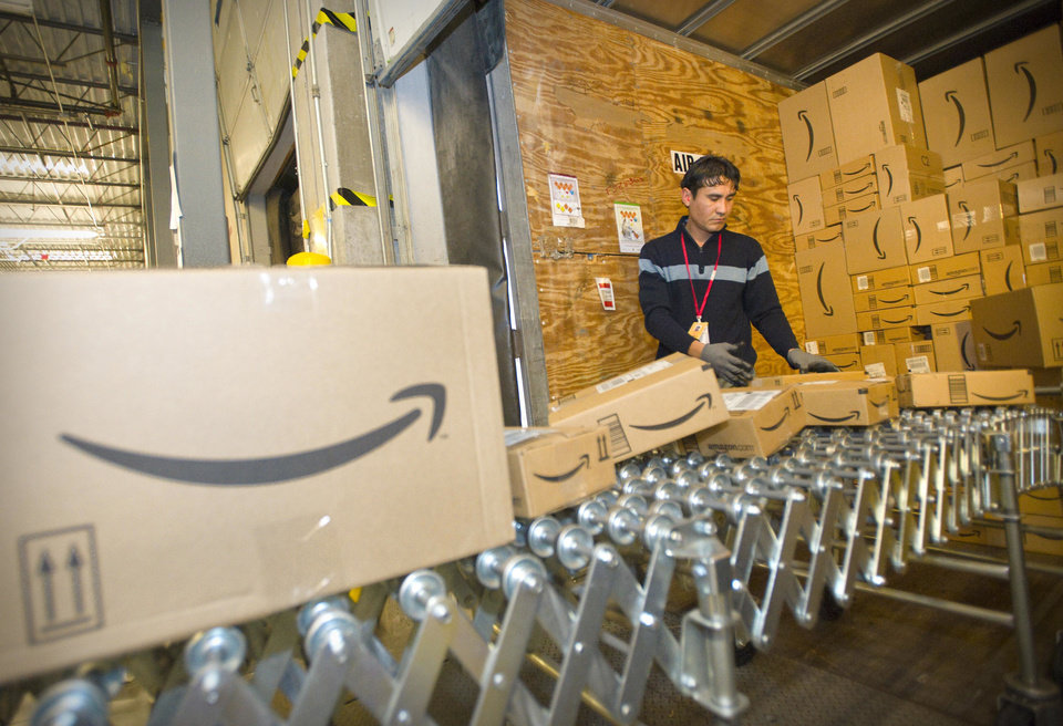 Photo - An Amazon.com team member loads boxes of fulfilled orders into a truck at their Fernley, Nev., warehouse on Monday, Dec. 1, 2008.  Amazon.com, which began running holiday promotions a week ago, said it is focusing less on Cyber Monday than the holidays as a whole. (AP Photo/Scott Sady) ORG XMIT: NVSS101