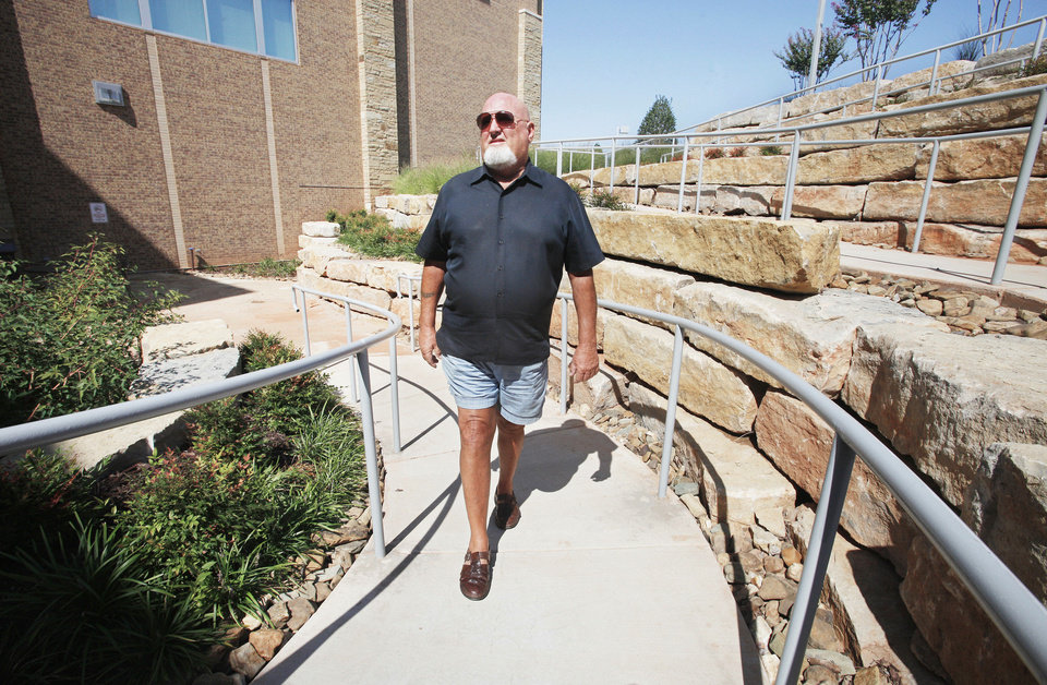 Tom Howard, a stroke patient, walks outside at Integris Health Edmond, where he was the hospital's first emergency room patient when it opened in 2011.