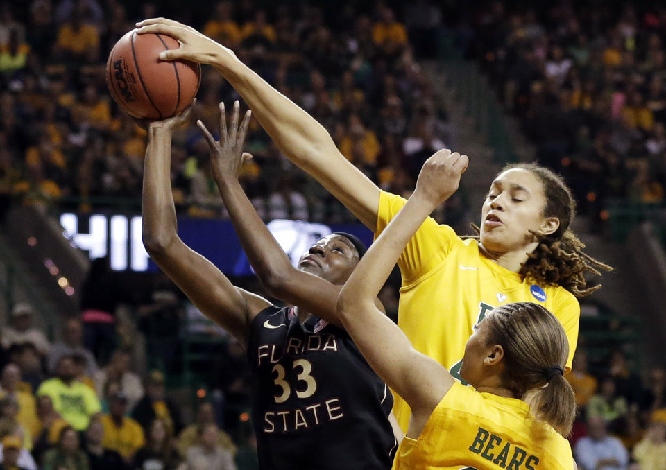 Florida State forward Natasha Howard (33) has her shot blocked by Baylor's Brittney Griner, right rear, as Alexis Prince, bottom, watches in the first half of a second-round game in the women's NCAA college basketball tournament, Tuesday, March 26, 2013, in Waco, Texas. (AP Photo/Tony Gutierrez) ORG XMIT: TXTG108