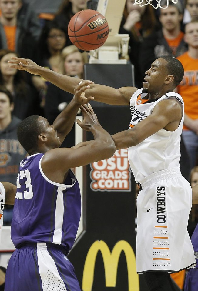 Oklahoma State's Le'Bryan Nash (2) defends on TCU's Devonta Abron (23) during the college basketball game between Oklahoma State University Cowboys (OSU) and Texas Christian University Horned Frogs (TCU) at Gallagher-Iba Arena on Wednesday Jan. 9, 2013, in Stillwater, Okla. 