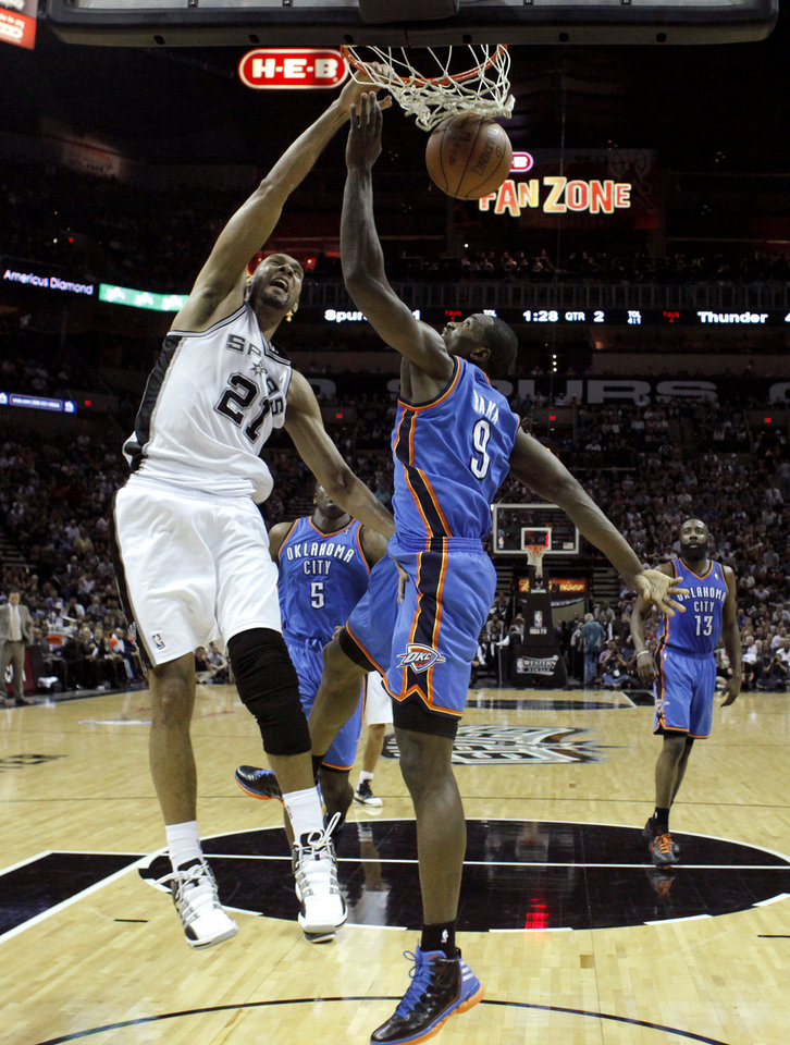 San Antonio's Tim Duncan (21) dunks over Oklahoma City's Serge Ibaka (9) during Game 2 of the Western Conference Finals between the Oklahoma City Thunder and the San Antonio Spurs in the NBA playoffs at the AT&T Center in San Antonio, Texas, Tuesday, May 29, 2012. Photo by Bryan Terry, The Oklahoman