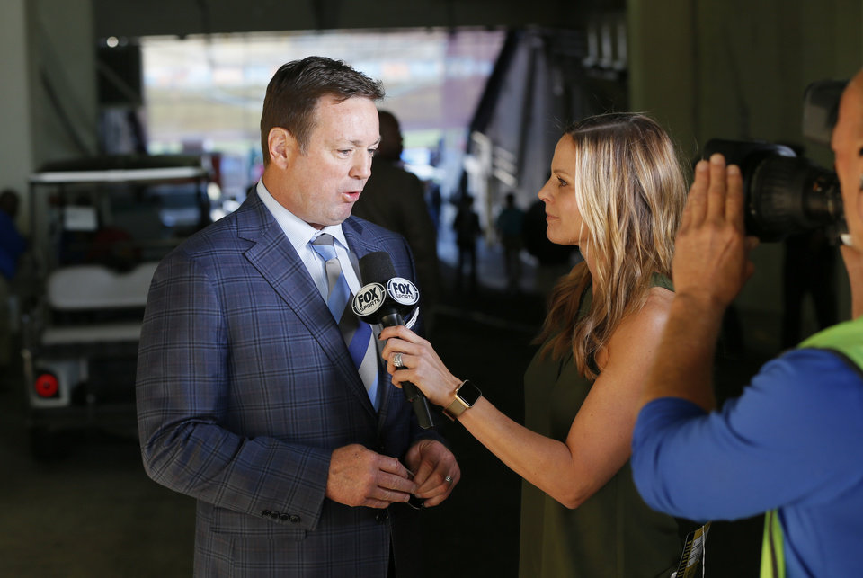 Photo - OU coach Bob Stoops is interview by Shannon Spake after arriving at the stadium for the Red River Showdown college football game between the University of Oklahoma Sooners (OU) and the Texas Longhorns (UT) at Cotton Bowl Stadium in Dallas, Saturday, Oct. 8, 2016. Photo by Nate Billings, The Oklahoman