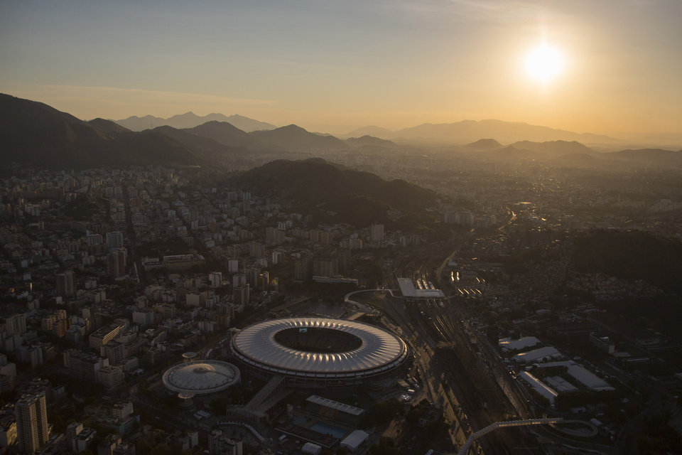 Photo - 10ThingstoSeeSports - Aerial view of the Maracana stadium is seen during sunset in Rio de Janeiro, Brazil, Sunday, June 8, 2014. The Word Cup soccer tournament is set to begin in just a few days, with the opening match on June 12 and Maracana stadium will host the World Cup Final match on July 13. (AP Photo/Felipe Dana, File)