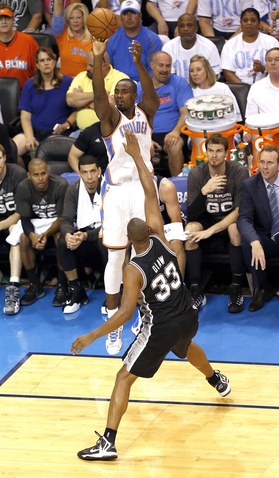 Photo - Oklahoma City's Serge Ibaka (9) shoots over San Antonio's Boris Diaw (33) during Game 6 of the Western Conference Finals in the NBA playoffs between the Oklahoma City Thunder and the San Antonio Spurs at Chesapeake Energy Arena in Oklahoma City, Saturday, May 31, 2014. Photo by Nate Billings, The Oklahoman