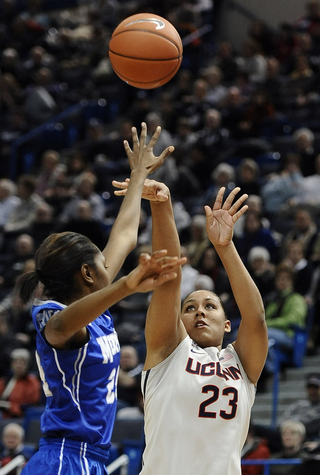 Photo - Connecticut's Kaleena Mosqueda-Lewis shoots over Memphis' Mooriah Rowser, left, during the first half of an NCAA college basketball game Wednesday, Jan. 22, 2014, in Hartford, Conn. (AP Photo/Jessica Hill)