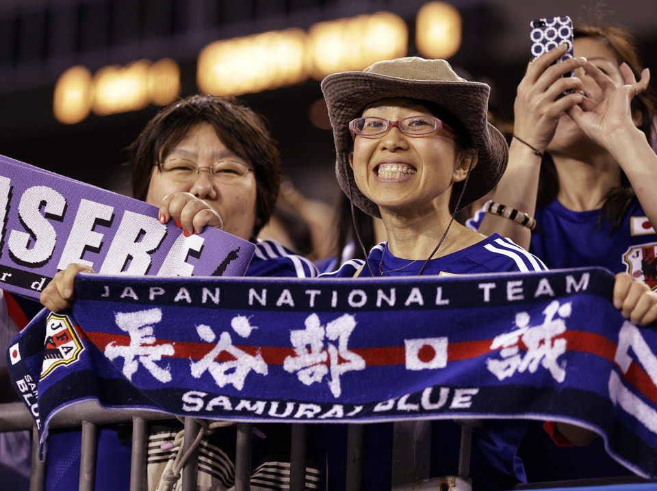 Photo - Japan fans cheer their team on during the first half of a friendly soccer match against Costa Rica Monday, June 2, 2014, in Tampa, Fla. (AP Photo/Chris O'Meara)