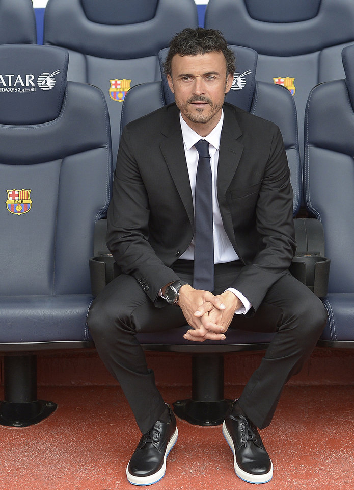 Photo - Luis Enrique looks on from the bench during his official presentation as new coach of FC Barcelona at the Camp Nou stadium in Barcelona, Spain, Wednesday, May 21, 2014. Former Barcelona player Luis Enrique signed a two-year contract to become coach on Wednesday, a hire the club hopes will resemble the success stories of Johan Cruyff and Pep Guardiola. (AP Photo/Manu Fernandez)