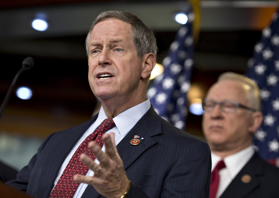 Photo - House Military Personnel subcommittee Chairman Rep. Joe Wilson, R-S.C., left, accompanied by House Armed Services Chairman Rep. Buck McKeon, R-Calif., gestures during a news conference on Capitol Hill in Washington, Friday, March 1, 2013, to talk about the effect of the automatic budget cuts on the military. (AP Photo/J. Scott Applewhite)