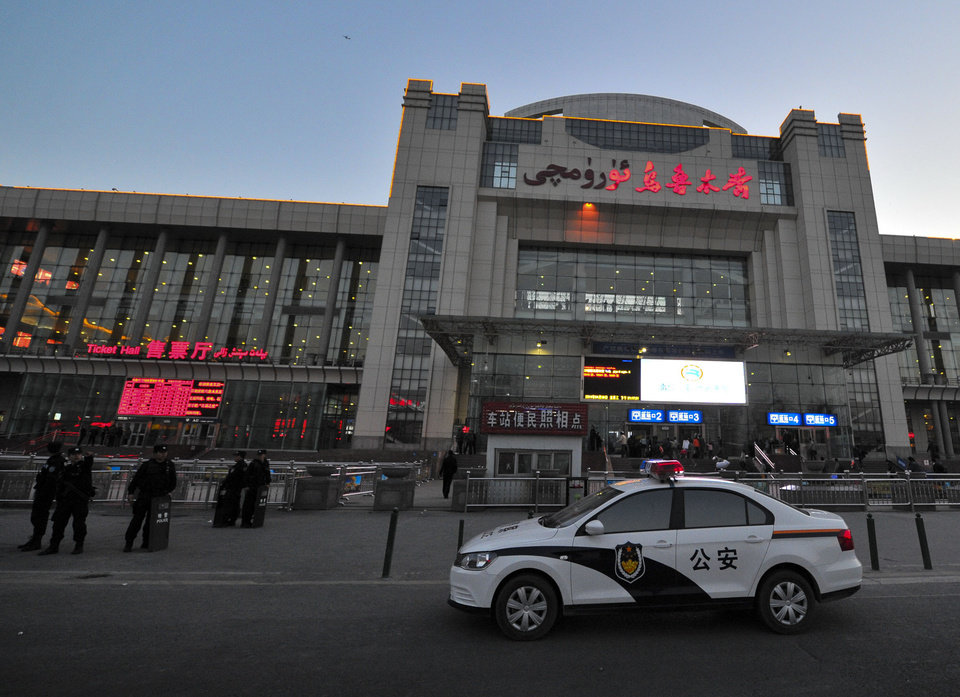 Photo - Chinese police men guard the entrance to the Urumqi South Railway Station in Urumqi in northwest China's Xinjiang Uygur Autonomous Region Wednesday April 30, 2014.  An explosion shook the railway station in China's restive far-western region of Xinjiang, injuring many people as President Xi Jinping wrapped up a four-day visit to the area, state media said Wednesday. (AP Photo) CHINA OUT ONLINE OUT