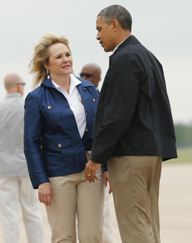 Photo - Oklahoma Governor Mary Fallin greets President Obama at Tinker Air Force Base after his arrival Sunday May 26, 2013. The President is in Oklahoma to tour the Moore tornado area and meet with families. Photo by Bryan Terry, The Oklahoman.